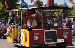 Yellow trolley with flags and Shriners decals